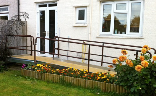 Perfectly Fitted Wheelchair Ramp with Warm Touch Handrails